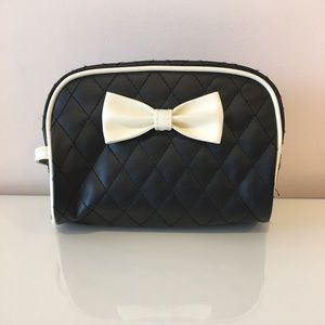 Handbags - Makeup Bag black quilted with white bow. NWOT